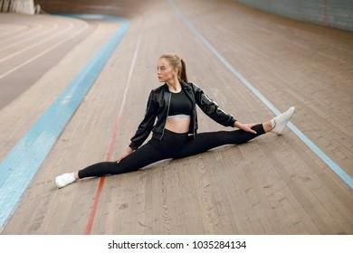 Fitness sport girl in fashion sportswear doing twine