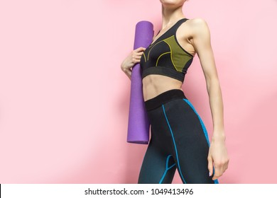 Fitness sport girl with yoga mat over colorful background