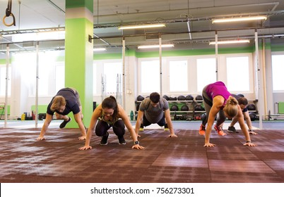 fitness, sport and healthy lifestyle concept - group of people exercising in gym