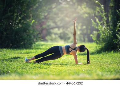 Fitness, sport lifestyle concept making yoga exercises on mats outdoors
