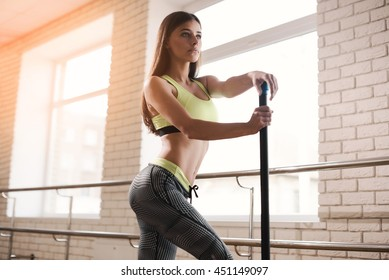 fitness, sport, people and lifestyle concept - close up of sportsmen exercising with bars and step platforms in gym