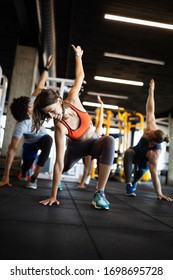 Fitness, sport, training and lifestyle concept. Group of people exercising in gym