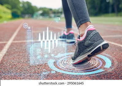 fitness, sport, training, people and healthy lifestyle concept - close up of woman feet running on track with futuristic holograms from back