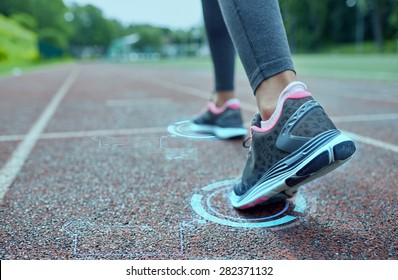 fitness, sport, training, people and lifestyle concept - close up of woman feet running on track from back with futuristic holograms