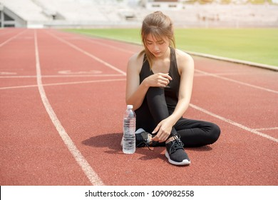 Fitness sport woman with drinking water in the summertime.
