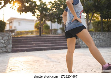 Fitness sports women warm up by stretching before have a run in the village center park