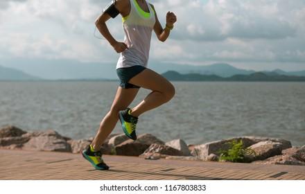 Fitness sportswoman running on sunny coast