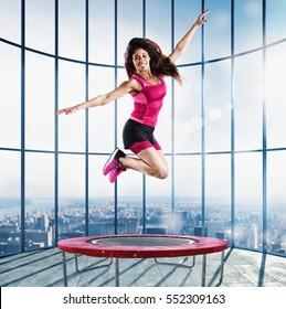 Fitness teacher jump at the modern gym