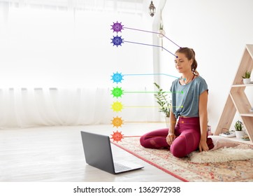 fitness, technology and healthy lifestyle concept - woman with laptop computer at yoga studio with seven chakra symbols