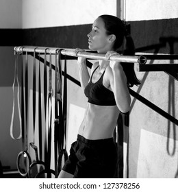 Fitness toes to bar woman pull-ups 2 bars workout exercise at gym