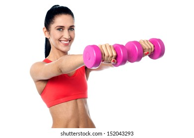 Fitness trainer stretching out her arms