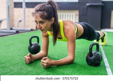 Fitness training athletic sporty woman doing plank exercise in gym or yoga class concept exercising workout aerobic.