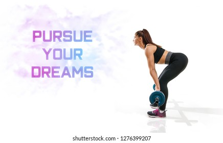 Fitness wallpaper / background young fit woman lifting weights, Pursue your dreams - Motivational and inspirational quotes ;