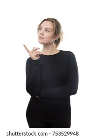 fitness woman all in black in deep thought looking and pointing with her finger up to the side