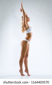 Fitness woman with a beautiful body full height