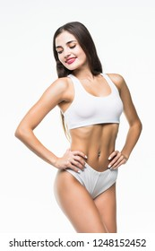 Fitness woman with a beautiful body isolated on white background