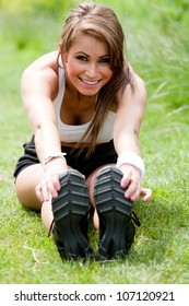 Fitness woman. Beautiful fit woman training to music. Concept sport and fitness