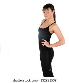 Fitness woman in black sports clothes isolated on white.