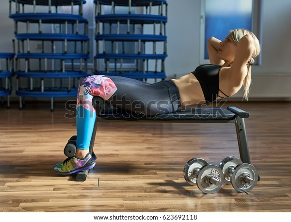 Fitness woman doing abs workout in a gym