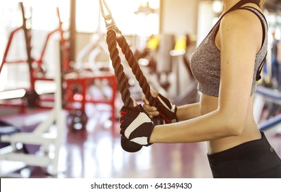 Fitness woman doing exercises. Concept of healthy lifestyle in the gym.