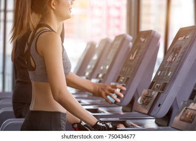 Fitness woman doing exercises on the treadmill. Concept of healthy lifestyle in the gym.