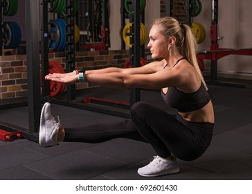 Fitness woman doing pistol squat in the gym