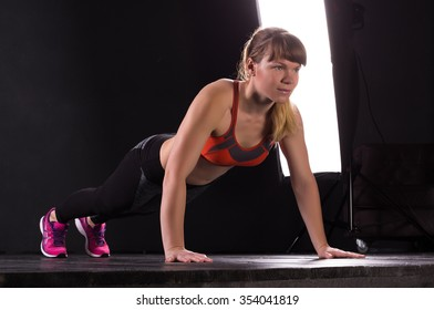 Fitness woman doing push-ups during her training