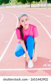 Fitness woman doing stepping up exercise in running field