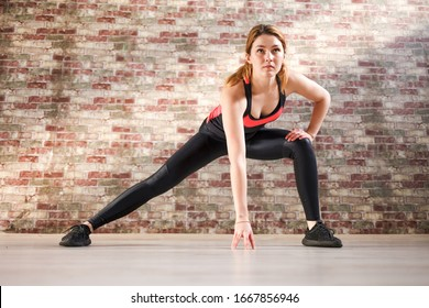 Fitness woman doing stretching indoor