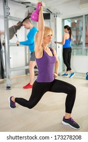 Fitness woman doing a weight training with kettle bell