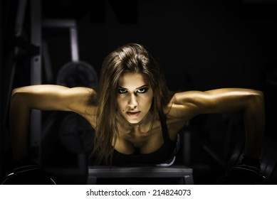 fitness woman exercising push ups in the gym fitness woman exercising push ups