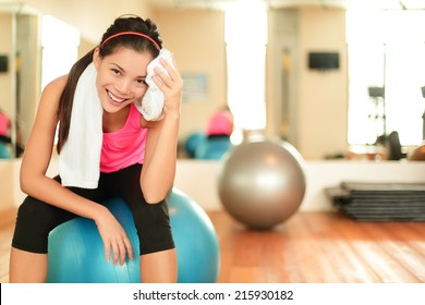 Fitness woman in gym resting on pilates ball