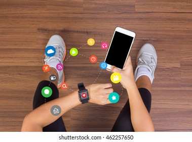 Fitness woman hand with wearing watchband touchscreen smartwatch, holding mobile phone with applications icons flat design ideas concepts living healthy life