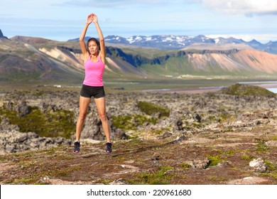 Fitness woman jumping exercising outdoors doing jump squats in amazing nature landscape. Fit female athlete cross-training outside. Image from Iceland.