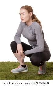fitness woman kneeling on grass