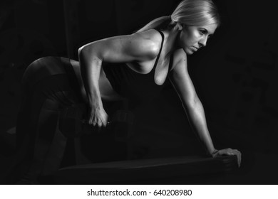 Fitness woman on black background - Stock imageGym, Exercising, Activity, Body Building, Human Muscle