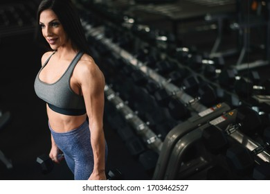 Fitness woman on training. Young woman in the gym.