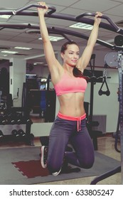 Fitness Woman Performing Hanging Leg Raises Exercise - One Of The Most Effective Ab Exercises.
