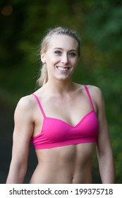 Fitness woman posing on a running trail