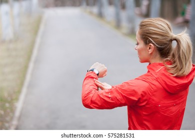 Fitness woman preparing for a running session.