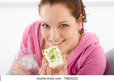 Fitness - woman relax with glass water snack on white