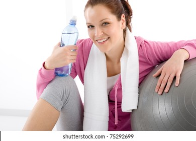 Fitness woman relax water bottle ball sportive outfit