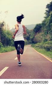 fitness woman runner running on trail