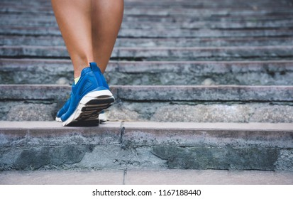 Fitness woman running up the old stairs. Legs running and burn out fat for fit body, Healthy and lifestyle concept poster