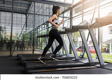 Fitness woman running on running machine at gym, Fat Burning Cardio Workout
