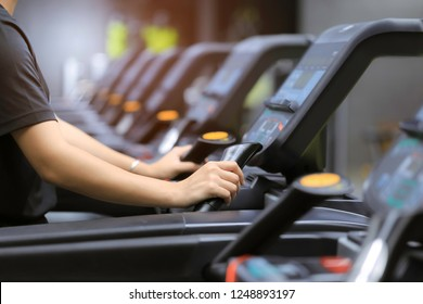 Fitness woman running on treadmill and burn fat in the body in the gym, Healthy lifestyle and sport concept