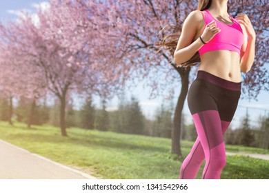 Fitness woman running at park