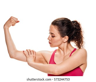 fitness woman showiing biceps muscles