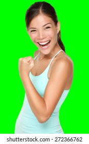 Fitness woman showing fresh energy flexing biceps muscles smiling happy isolated cutout on green chroma key background. Fit mixed race Asian Caucasian female fitness model energetic and fun.