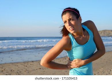 Fitness woman with side kidney pain. Female athlete with painful injury or spasm in serratus muscles.
